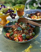 Rabbit leg with grapes and ratatouille