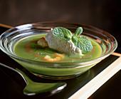 Pea soup with crème fraîche and mint