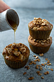 Apple muffins with granola and maple syrup