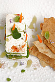 Cheese millefeuille with pea hummus