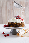 Sweet bread bake with pine pepper, cream and raspberries