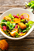 Winter salad with baked halloumi and beetroot pesto