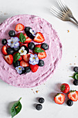 Summer Berry Cheesecake Decorated WIth Strawberries, Blueberries And Pansies