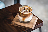 Iced coffee with milk on a wooden board