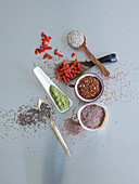 Various seeds, matcha powder and goji berries