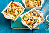 Rice and veggies bake (mushrooms, courgette, pepper) with mozzarella