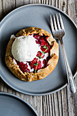 Sweet strawberry balsamic and thyme galettes wrapped up in a flakey buttery gluten-free crust