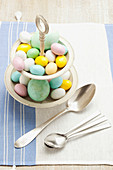 Colourful Easter eggs on a cake stand