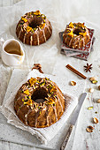 Three spice ring cake with a glaze and pistachios