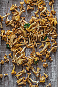 Fresh chanterelles with parsley on a wooden board