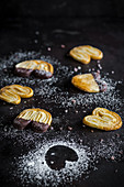 Pastry biscuits with powdered sugar and dark chocolate