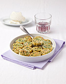 Gratin pasta snails with herb and ricotta filling