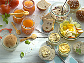Brunch with bread baked in a glass, jam, dips, muesli and fruit salad