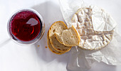 Camembert with baguette and a glass of red wine
