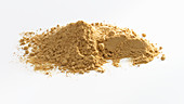 A pile of ginger powder against a white background