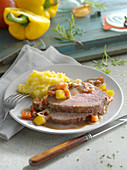 Roast beef braised in red wine with peppers and mashed potatoes