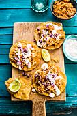 Mexican tinga on tostadas