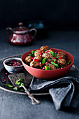 Lamb balls with pomegranate dressing