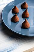 Tasty chocolate truffles on table