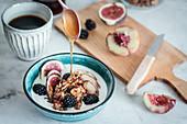 Yogurt with fruits, granola and honey