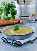 Potato soup with bockwurst and parsley