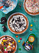 No bake cheesecake with candy, oreos, cookies and chocolate