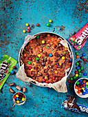 Cake with candy, bounty and skitters