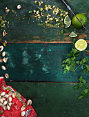 Pistachios, lime and parsley background