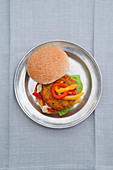 Chickpea and carrot burger in a roll with peppers