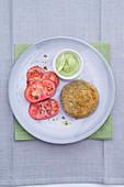 Portobello burger with guacamole and tomato salad