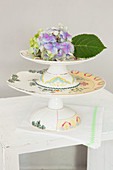 Hydrangea flower on top of stacked cake stands
