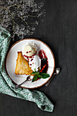 French cake with caramelized pear, chilli whipped cream and vanilla ice cream