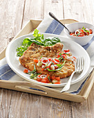 Breaded pork chop with tomato and spring onion salad