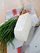 Primosale and chives on a white porcelain board