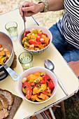 Woman eats paprika and sweet potato stew