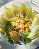 Rice salad with cashew nuts on chicory