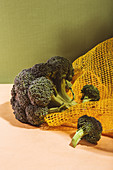 Raw fresh broccoli in a yellow bag