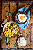 Fake 'fried potatoes' made from kohlrabi with fried egg and mustard cream
