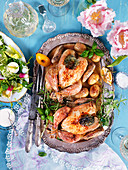 Easter oven baked chicken with herbs, potatoes and salad