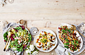 Green salad with pickled grapes, Warm potato salad with cheesy sauce and Festive slaw