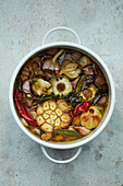 Garlic confit with chillies and herbs
