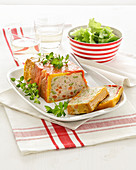 Turkey meatloaf wrapped in bell peppers with green salad