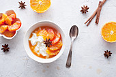 Rice porridge with blood oranges marinated in cinnamon and star anice