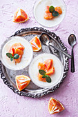 Yogurt pannacotta with blood oranges and mint