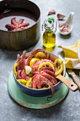 Warm octopus salad with fried lemon slices and garlic