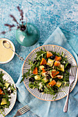 Rocket salad with butternut squash and avocados