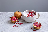 Yogurt with pomegranate seeds in a ceramic bowl