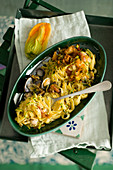 Carbonara with courgettes, clams and crispy flowers and breadcrumbs