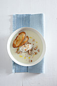 Celeriac soup with ricotta and walnuts