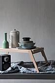 Crockery on tray with legs above speaker
